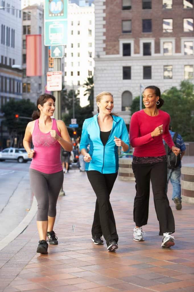 Three healthy women walking.