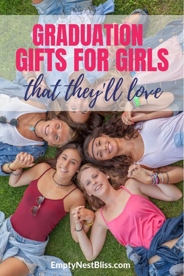 Six teenage girls holding hands lying in a circle on the grass.  Graduation gifts for girls.