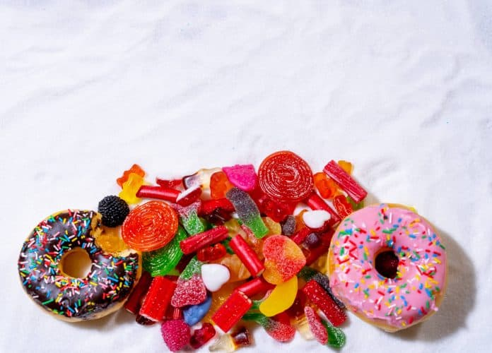 Pile of Candy on a Marble Background. You'll need to do a sugar detox if you eat all that.