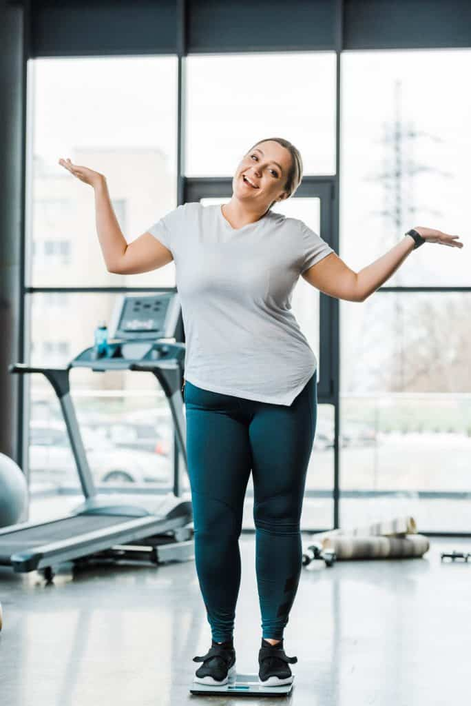 Happy woman at the gym.