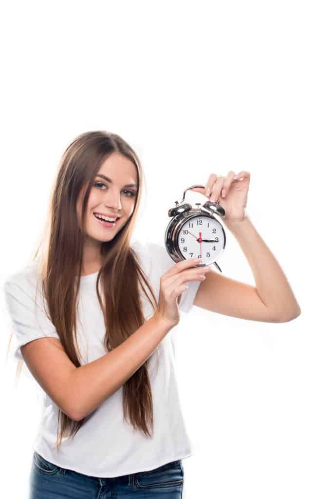 Woman holding a clock.