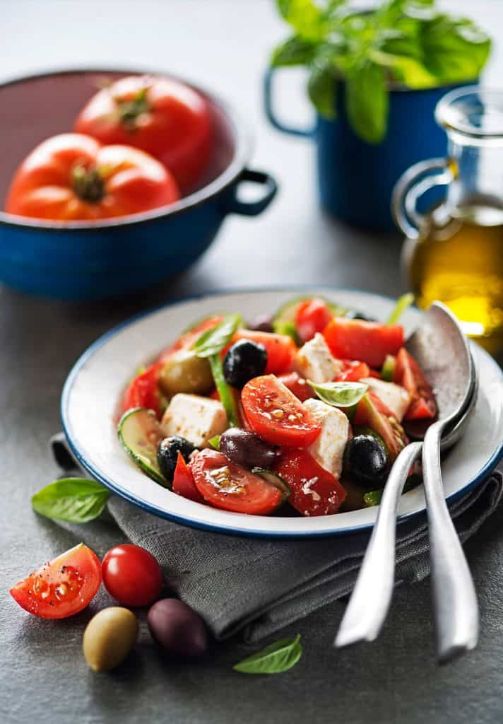 Tomato and olive salad with basil.