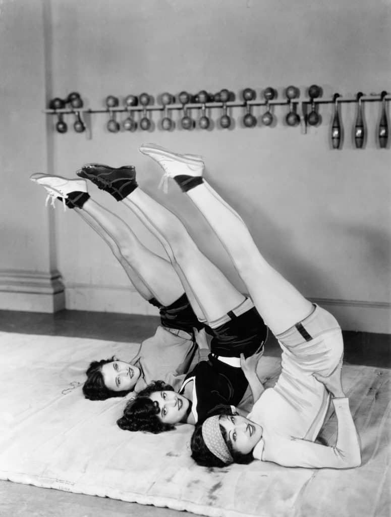 Old black and white photo of three women exercising in a gym.  Add exercise if you can't lose weight.