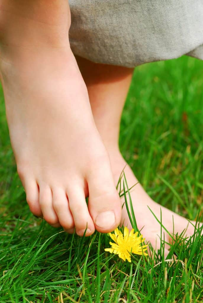 barefoot earthing on grass