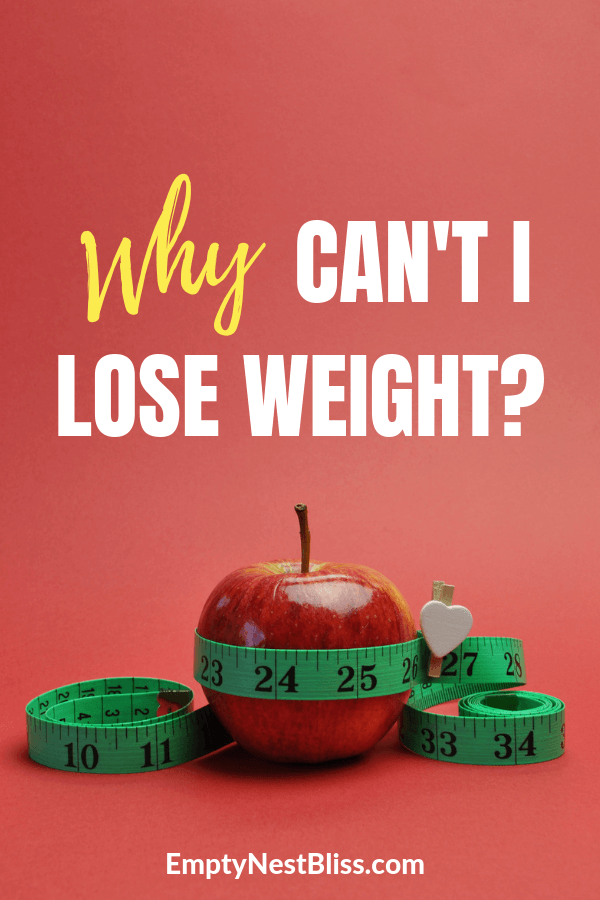 Red background with red apple and green tape measure.  Text that says why can't i lose weight.